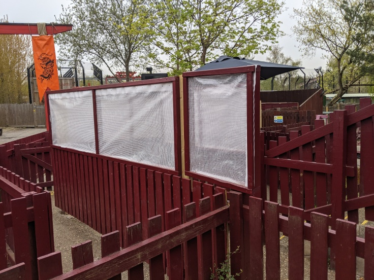 Plastic sheeting barriers in the queue of Dragon's Fury at Chessington