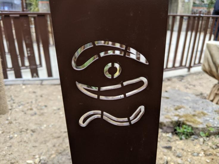Hieroglyph in the queue fence of Croc Drop
