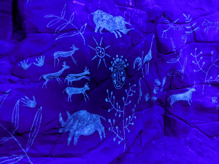 Glow in the dark cave paintings seen during Zufari at Chessington