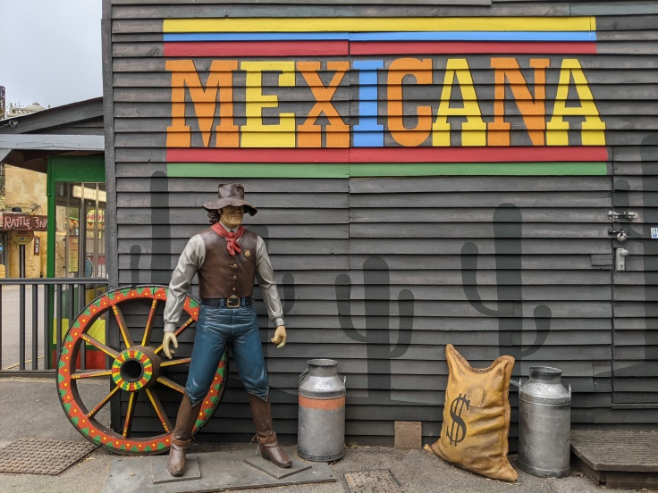 Mural featuring cowboy statue and painted cacti in Mexicana at Chessington