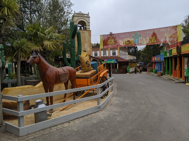 Mexicana area at Chessington showing horse and cart theming and banner