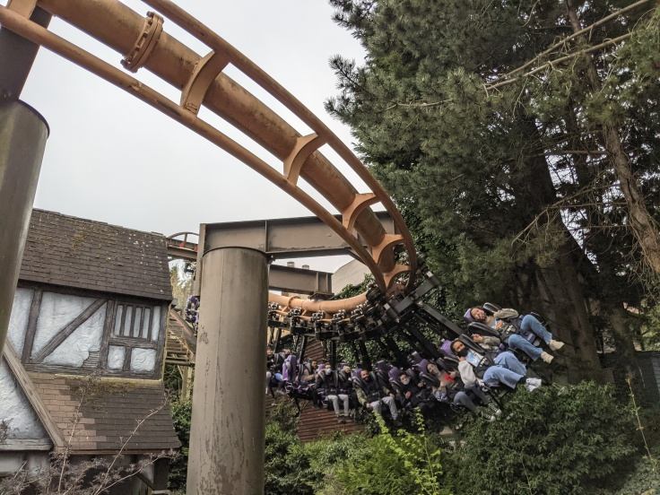 A train of riders on Vampire at Chessington