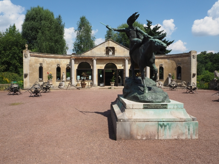 The Pavilion at Beale Wildlife Park with a statue of a Valkyrie in the foreground